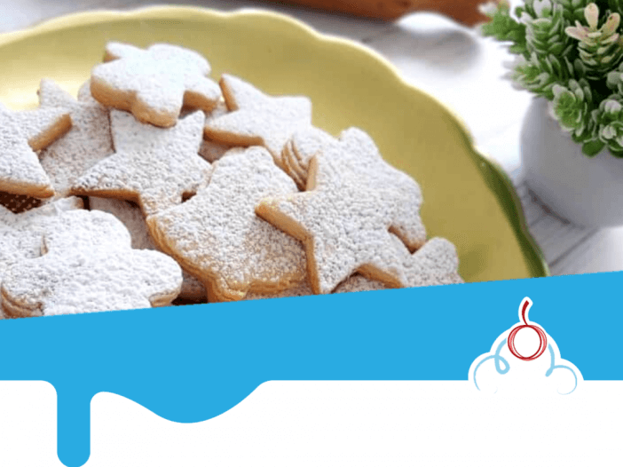 Galletas en forma de estrella polvoreadas con azucar glass